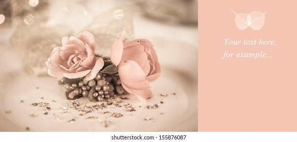 Elegant and romantic dinner setting with rose decoration and lights,copy space with leaf decoration