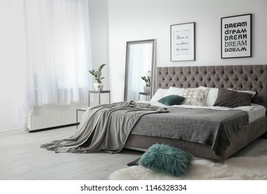 Elegant room interior with large comfortable bed