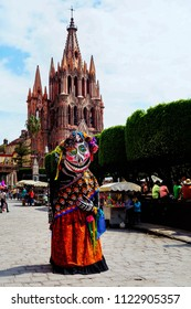 Elegant but sad skeleton woman death character fully dressed and painted. Catrina. June 2015, San Miguel de Allende.