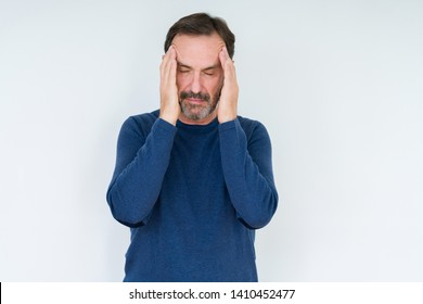 Elegant senior man over isolated background with hand on head for pain in head because stress. Suffering migraine.
