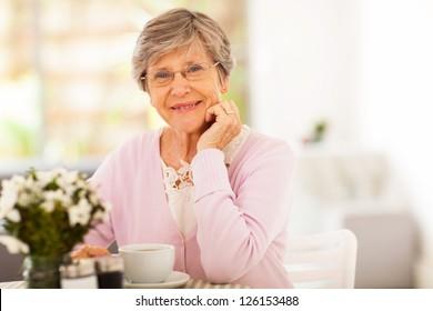 elegant senior woman having tea