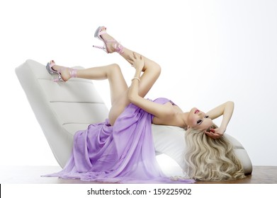 Elegant sensual young woman in dress