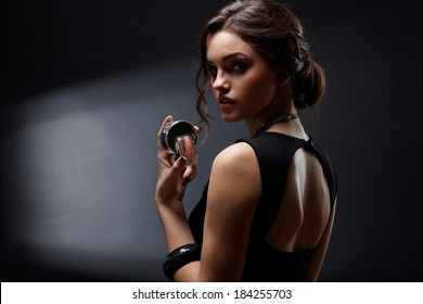 Elegant sensual young woman holding perfume, Fashion photo