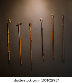 elegant Set of walking sticks and crutches. Telescopic metal canes, wooden cane with additional support, elbow crutch. Medical devices for help accident people