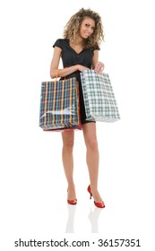 Elegant sexy woman with shopping bags isolated over white background