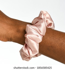 Elegant Silk hair scrunchies on background brown white and pink