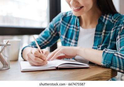 Elegant smart woman writing down her ideas