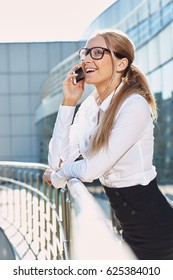 Elegant smiling business woman talking on the phone