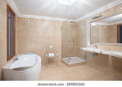 Elegant spacious bathroom interior in beige colors