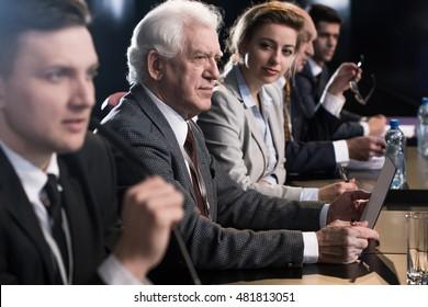 An elegant speaker makes statement during media conference
