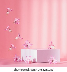 Elegant spring showcase with white square podium for display cosmetic and goods with flow of tender hyacinth flowers fly  in sunlight, striped shadows on pink background, square.