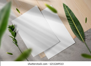 Elegant stationery mockup set, letterhead, with floral shadows overlays, floral elements, top view, on wooden background.