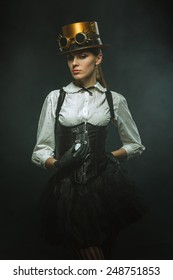 Elegant steampunk girl with the clock.
