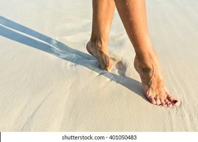 Elegant step on a sandy coral beach