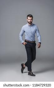 elegant stylish businessman in formal wear, on grey