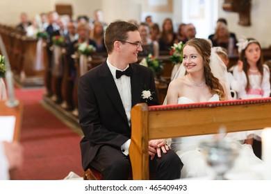 elegant stylish cute groom and bride  on the wedding ceremony