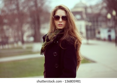 Elegant stylish girl with long hair and glasses