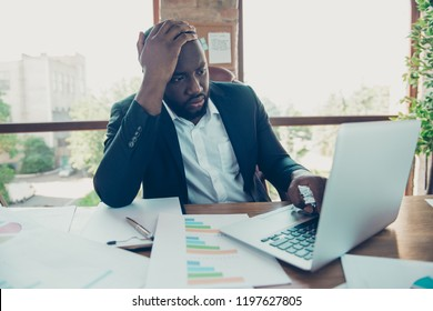 Elegant stylish handsome pensive business shark, man in jacket, typing on laptop, thinking about project growth, progress at work place, work station