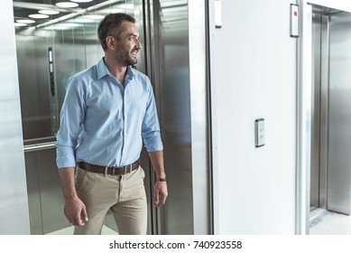 Elegant stylish man is getting out of lift