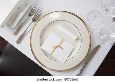Elegant table set at fine restaurant. Wedding reception.