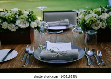 Elegant table set up for wedding reception or banquet dinner outdoor