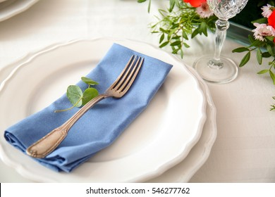 Elegant table setting with beautiful flowers, closeup