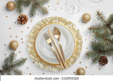 Elegant table setting on light background, top view. Christmas celebration