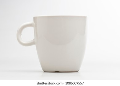 Elegant tea or cafe white blank mug isolated