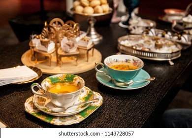 elegant tea cup on a dark wooden table. fancy afternoon tea concept.