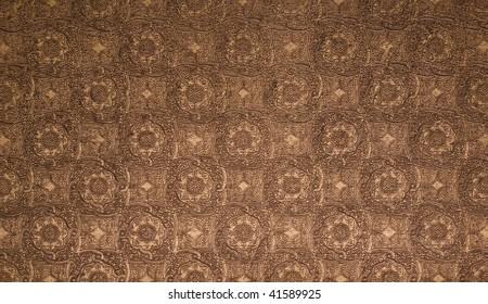 Elegant tooled leather pattern.