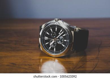 Elegant watch on wood table - retro filter