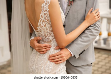 Elegant wedding couple. Bride and groom embracing at wedding day