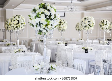 elegant wedding reception table arrangement, floral centerpiece