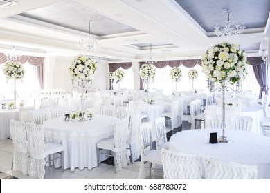 elegant wedding reception table arrangement, floral centerpiece