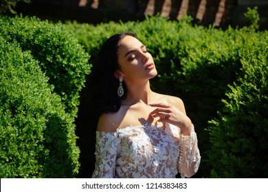 Elegant wedding salon is waiting for bride. woman is preparing for wedding. Beautiful wedding dresses in boutique. Happy bride before wedding. Wonderful bridal gown. Saying yes. Happy moment.