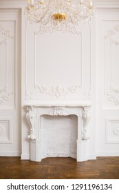 Elegant white fireplace in beautiful white room