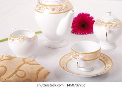 Elegant white porcelain tableware with luxury gold decal design