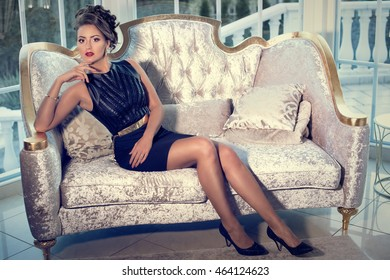 elegant woman in a black cocktail dress