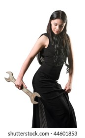 The elegant woman in a black dress with a spanner
