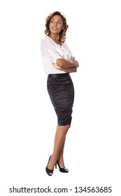 Elegant woman in a black skirt looks at an object to her side, isolated on white background.