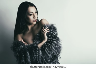 elegant woman in a black and white coat