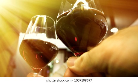 Elegant woman drinking red wine in luxury resaurant celebrating birthday or dating with her male friend sun flare terrace