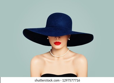 82d1c27fce8 Elegant woman fashion model with red lips makeup wearing classic hat and  white pearls
