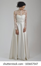 elegant woman in  fashionable  stylish dress posing in the studio
