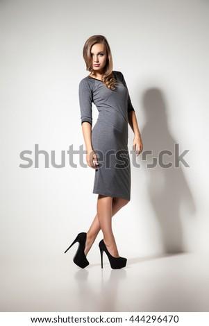 d2fa3b0dc722 Elegant Woman Grey Dress High Heels Stock Photo (Edit Now) 444296470 ...
