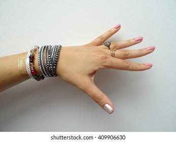 Elegant Woman Hand with Bracelets