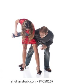 Elegant woman in high heels overpowering an attacker using a joint lock