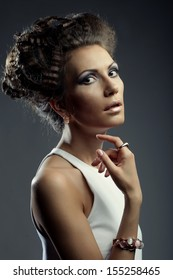 Elegant woman with luxury make up and hairstyle. Studio shot.