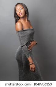 Elegant Woman in Metallic Off Shoulder Dress