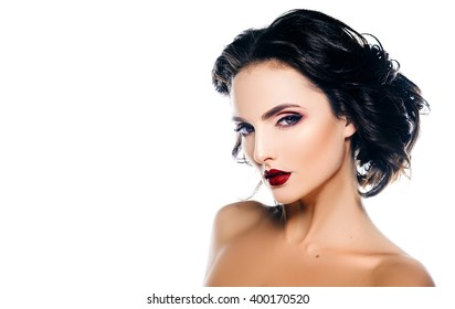 Elegant woman model with makeup and hair on a white background
